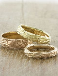 Unique nature-inspired his and hers wedding bands by Ken & Dana Design in NYC.
