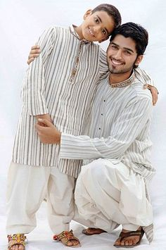Pakistani man and a child wearing shalwar kameez.  The shalwar kameez is the national dress of Pakistan and is worn by men and women in all four provinces Punjab, Sindh, Baluchistan, Khyber Pakhtoonkhwa and FATA in the country and in Azad Kashmir.