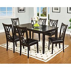@Overstock - This tasteful contemporary dining set features leatherette seating and criss-cross chair back design with style that will last for years to come. This set includes one dining table and six elegant chairs.http://www.overstock.com/Home-Garden/Sophala-Contemporary-7-piece-Espresso-Finish-Dining-Set/6613820/product.html?CID=214117 $728.99