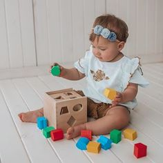 "This ultimate shape sorter features 12 chunky, vibrantly colored shapes that make a satisfying ""clunk"" as they drop into the natural-finish hardwood cube. Then open the lid, take them out and start all over again! A classic educational toy for toddlers.    #educationaltoys #developmentaltoys #classictoys #woodentoys #melissanaddoug #melissaanddougtoys #learningthrouglpay #motorskills Educational Toys For Toddlers, Educational Activities, Cube Toy, Wooden Shapes, Developmental Toys, Different Shapes, Classic Toys, Toddler Toys, Motor Skills"