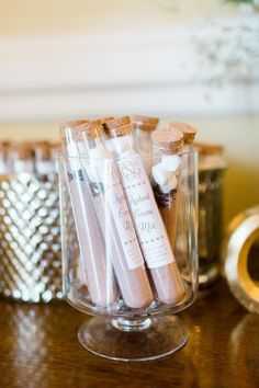 Winter wedding favor idea - instant cocoa mix in clear tubes {Erin Wilson Photography}