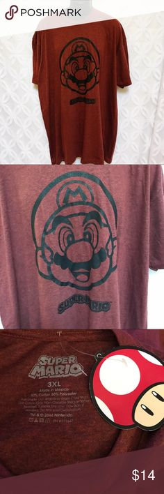 """Super Mario Bros Nintendo Heather Red Tee NWT Super Mario Bros Nintendo Heather Red Tee NWT.                      PLEASE READ down sizing husband Tees collection. Measurements Laying Flat Size 🔹3XL Armpit to Armpit 🔹29"""" Shoulder to Hem 🔹 33"""" Bundle to Save 🤓 Sorry NO outside transactions 🚫 NO trades 🚫 Reasonable Offers welcomed 👍 NO Low balling 👎 NO Holds👎 All items from a pet 😼and Smoke Free Home  Happy Poshing 🤗 Nintendo Shirts Tees - Short Sleeve"""