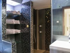 Black and grey bathroom with mosaic lights