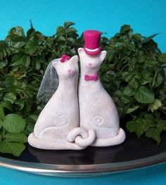 @Brittany Martin I wonder if you could make something similar with your clay molding skills :) I've been looking all over for a cake topper like this except I want their tails to be curled into a heart
