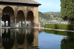 Granada and Water - The Partal Pavilion, Alhambra Palace. On a hot summer day, a mirror of water can persuade us to feel cooler, more refreshed. Just contemplating the image reflected in the water of this pond produces a sense of calm and tranquility, helping us to forget the rigours of high summer heat.  This is just one of the water features in the Alhambra, the Moorish creators of the ancient palace certainly knew how to make it a place full of pleasure and beauty.