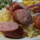 Slow Cooker Kielbasa and Beer Recipe - 2 lbs kielbasa sausage - cut into 1 in. pieces, 12 oz. beer, 20 ounce can sauerkraut, drained - put in crock pot and cook on low 5-6 hrs.  Serve w/ honey mustard over mashed red potatoes.