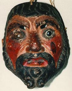Dance of the Christians & Moors - Guatemala  Fine old masks such as this are highly valued by collectors and museums. Carved in semi-hardwood with glass eyes. The mask has been well used and its back has a rich, dark patina more common to old Guatemalan masks than Mexican ones.  Age: Approx. 100 years.