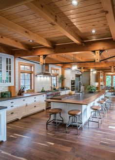 The hardwood floors throughout the main level are reclaimed walnut provided by Pioneer Millworks, the sister company to New Energy Works. The countertop on the spacious kitchen island is also reclaimed walnut.
