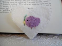 Felt Bookmark Bird Corner Heart Shape Embroidered Wool Felted Book Mark  This is the perfect gift for that person who has everything but, loves to read ! Bookmark is made from quality wool felt. The bird is done in a soft purple color. The two hearts are sewn together with a blanket stitch and fits on to the pages perfectly without damaging the pages. I hand embroidered the flower branch using light brown for the branch and bright aqua for the flowers using French knots. HIs/Her feet wer...