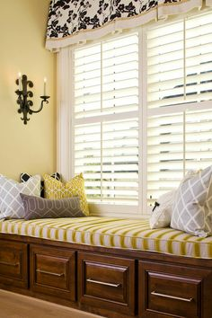 For more of a dressed feel, add a simple boxed valance to your shuttered window. Mounting it above the window maximizes the light.