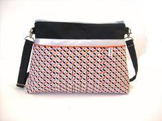 sac bandouliere noir a motifs graphiques vintage en toile-sac zippé tissu imprimé géometrique-pochette orange et noire-sac printemps/été