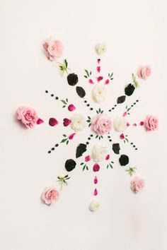 Combining the uber stylishtalents of The Shift Creativewith the prettiest blooms byLavenders Flowers, the idea fora fresh floral mandala backdrop was born. It's simple, seriously beautiful and all it takes arefresh blooms, a bare wall and a little time. It's