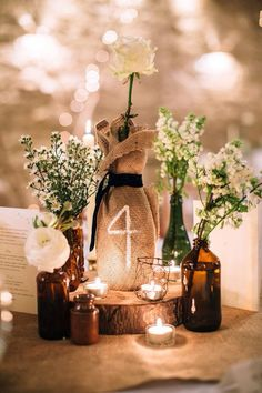 romantic wedding table with flower and candle                                                                                                                                                                                 More