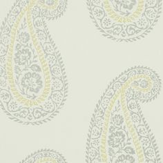 Madira Wallpaper A woodblock style print wallpaper with a large scale paisley motif repeated in silver and yellow on an ivory background.