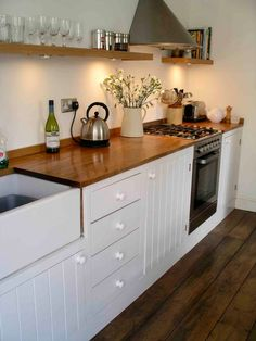 traditional bespoke kitchen with painted tongue and groove doors ste in fully framed cabinets