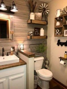 What a beautiful and welcoming famhouse style bathroom! The wood accent wall and floating shelves really bring dimension to the room.