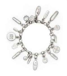 Current Christie Auction! Damien Hirst   Pharmaceutical pills charm bracelet.