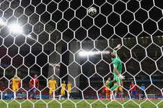 Jorge Valdivia of Chile shoots and scores his teams second goal against goalkeeper Mathew Ryan of Australia during the 2014 FIFA World Cup Brazil Group B match between Chile and Australia at Arena Pantanal on June 13, 2014 in Cuiaba, Brazil. (Photo by Matthew Lewis/Getty Images)
