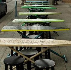 Re-purposed ironing boards, used as Bakesale Betty's dining tables...