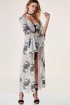 Stunning maxi kimono made of sheer chiffon material. Intricate floral embroidery throughout with bell sleeves and ties for closure.