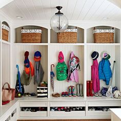 """Our mudroom solves early-morning and after-school clutter chaos,"" says Sue. ""It pretty much keeps everybody's stuff in one spot."" - FamilyCircle.com"