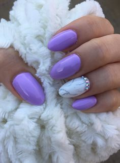 Purple nails with white marble.