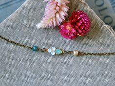 Opal and pearl choker necklace /short necklace /beaded choker /boho necklace.Tiedupmemories by tiedupmemories on Etsy https://www.etsy.com/listing/471793944/opal-and-pearl-choker-necklace-short