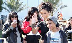 Rihanna wearing Fallon crystal bracelets, Jennifer Fisher cigar band ring, Jacquie Aiche 10 diamond hoop earrings, Xiao Wang Galaxy ring