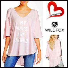 """❗️1-HOUR SALE❗️WILDFOX Coverup Tee Tunic 💟NEW WITH TAGS💟 RETAIL PRICE: $98  WILDFOX Tunic Swing Tee Coverup My Bags Are Packed Tahiti  * Relaxed Cape Silhouette  * V-neck, rounded hem & elbow length sleeves  * Incredibly lightweight    * Oversized fit  * About 25""""-30"""" long   Fabric:100% Cotton Item: Color: Cake # pastel pink 🚫No Trades🚫 ✅Offers Considered*/Bundle Discounts✅ *Please use the blue 'offer' button to submit an offer. Wildfox Tops Tunics"""
