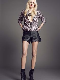 """Model wears Naughty Dog """"My chain"""" silk #shirt and a pair of black eco-leather #shorts."""