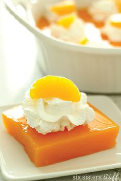 Bring some of the color of spring to your dessert table with this Smooth Orange Gelatin recipe! Creamy, delicate, and delightfully delicious, this simple dessert is best served topped with whipped cream, mandarin oranges, and sliced bananas.