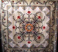 Log cabin border on incredible medallion-- love the color palette here. Amazing composition and artistry.