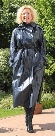 A lovely lady in shiny black rubber raincoat