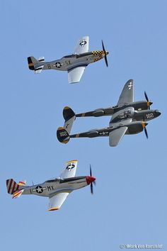 P 51 Mustangs and a P 38 Lightning