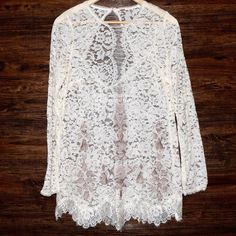 FREE PEOPLE Classic Top Patterned Bohemian Blouse Size Small. New without tags. $168 Retail + Tax.   Ivory & cream lace tunic with embroidered design, scalloped lace trim & loose-fitting silhouette. Open back button closure. Sheer, Unlined.  Size tag removed.  Cotton, nylon.  Imported.    • Measurements provided in comment(s) section below.    {Southern Girl Fashion - Closet Policy}   ✔️ Same-Business-Day Shipping (10am CT). ✔️ Reasonable best offer considered when submitted with offer…