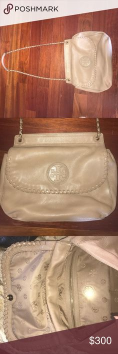 100% authentic Tory Burch bag Tan leather adjustable strap can be work on shoulder or messenger bag in good condition purchased directly from Tory Burch store in Troy, Michigan. Small signs of wear but a beautiful bag and lots of life left! Goes with any outfit! Tory Burch Bags Shoulder Bags