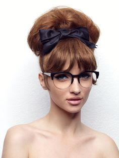 Big round frame with a bold brow, sides, and towering updo... fun!