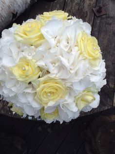 White hydrangea and lemon roses with a hint of stephanotis little pearls wedding bouquet, white and lemon