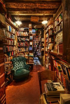 Books abound. I could stay an entire day curled up on that teal chair with the book and some green mate. Addition: an ottoman to put up my feet.