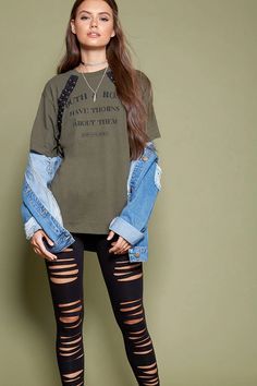"A knit tee featuring a ""Truth & Roses Have Thorns About Them"" graphic quoted by Henry David Thoreau, lace-up front, long sleeves, and a round neckline."