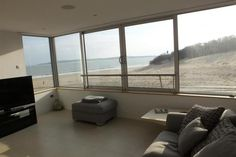 This fantastic first floor ultra modern beachside holiday apartment has been tastefully furnished and equipped perfect for a family holiday with the beach literally on your doorstep. The superb ever changing views of the south beach and bay from the large picture window in the lounge/dining/kitchen and master bedroom will keep you mesmerised. The South Beach restaurant is a stones throw away where visitors can enjoy a lovely lunch or evening meal.