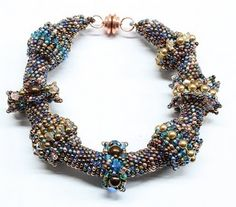 Sabine Lippert.  Beaded rings can be worn on a bead crochet bracelet or necklace.