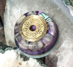 A 5 Element Balinese coin rests at the top of this palm sized orgonite to support the energy balancing potential of this orgone generator. Pieces…