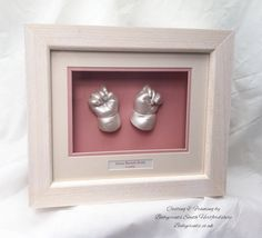 Little pearlescent baby hands framed in pinks. Magical.  By Babyprints.co.uk