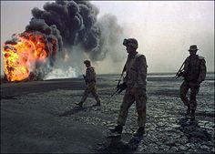 A US Marine patrol walked across the charred oil landscape near a burning well near Kuwait City on March during the Gulf War. Usmc, Marines, Invasion Of Kuwait, Operation Desert Shield, Iraqi Army, Once A Marine, Us Veterans, My War, Us Marine Corps