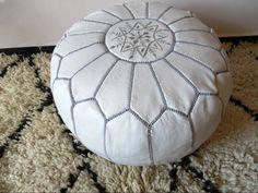 Design ottoman Pouffe Size: 48cm wide, 27cm high Material: 100% handmade goatskin Origin: Marrakech Creation moroccan-pouffe.com