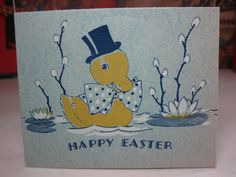 Adorable unused 1930's-40's Norcross easter greeting card duck wearing top hat and big bow floating on pond with lily pads and pussy willows