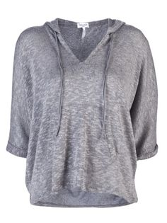 Melange loose knit hoodie in grey from Splendid. This sheer top features a drawstring hood, v-neck, short dolman sleeves with rolled cuffs, and a kangaroo pouch front pocket.