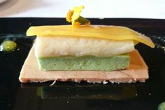 Slightly smoked European eel and avocado in spiced quince veil over foie gras with citric aroma - A Boroa Jatetxea dish