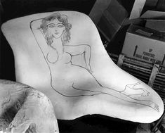 Charles and Ray Eames did not think of the cartoon as vulgar. As much as Steinberg admired the seminal work of the Eameses, they admired Steinberg's practice of crossing borders between media. Charles and Ray Eames later 'invited the nude woman to dinner', placing the chair in one of their collage settings for a photo shoot. The photo was taken by Charles Eames.
